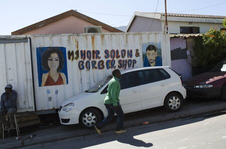 residents: IMIZAMO YETHU TOWNSHIP WESTERN CAPE SOUTH AFRICA - APRIL 2016 - A general view of the Imizamo Yethu township at Hout Bay and the sub standard housing in which the residents live. Here is the hair salon and barber shop