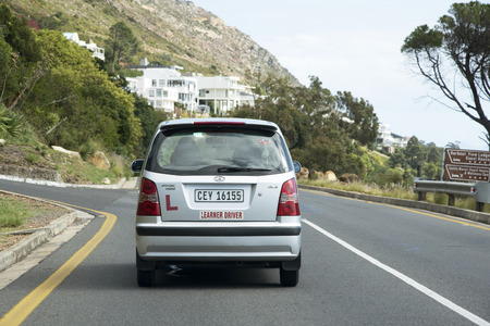 l plate: Learner driver under instruction on a South African street