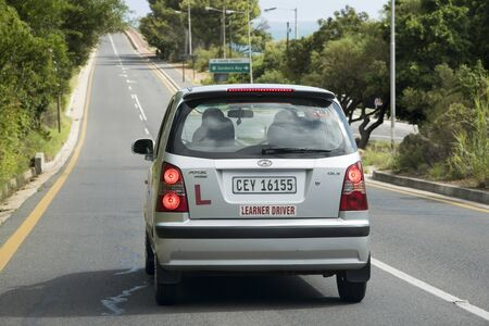 learner: Learner driver under instruction on a South African street