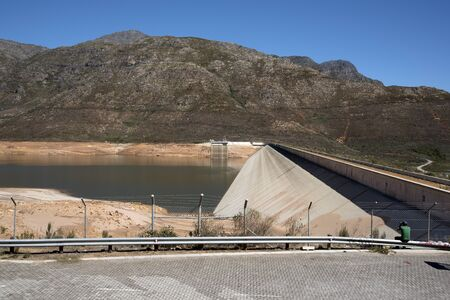berg: BERG RIVER DAM FRANSCHHOEK WESTERN CAPE SOUTH AFRICA - APRIL 2016 - The dam wall and low water level of the Berg River Dam Reservoir near Franschhoek in the Western Cape Southern Africa
