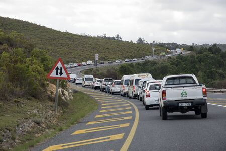 queueing: N2 HIGHWAY HOUWHOEK PASS WESTERN CAPE SOUTH AFRICA - APRIL 2016 - Following an accident a traffic queue on the N2 Highway as it enters the Houwhoek Pass close to Botrivier Western Cape