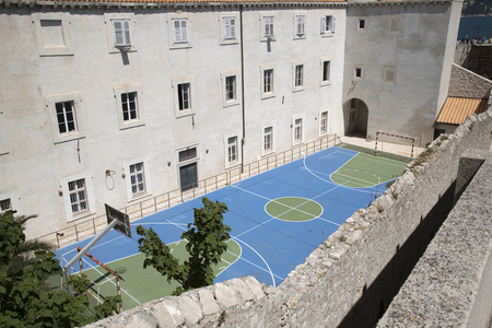 school sports: SPORTS COURT DUBROVNIK CROATIA - MAY 2016 - An overview of a school sports court marked for use in various sports Editorial