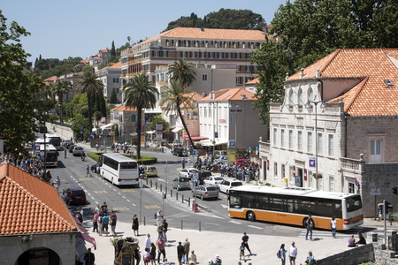 drop off: DUBROVNIK CROATIA - MAY 2016 - The bus and tourist coach drop off point outside  the Pile Gate of the historic Old Town in Dubrovnik Croatia