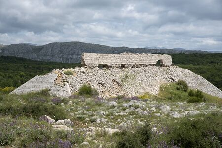 srd: MOUNT Srd DUBROVNIK CROATIA - MAY 2016 - The remains of a firing range on the summit of Mount Srd built with Limestone and used during the 1991-95 war in Croatia