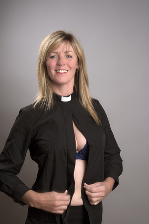 VICARS & TARTS PARTY Woman in costume of a vicar getting dressed