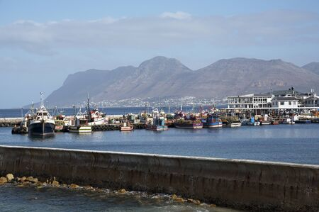fishing fleet: KALK BAY WESTERN CAPE SOUTH AFRICA - APRIL 2016 - The fishing harbor seen over the seawall at Kalk Bay in the Western Cape Southern Africa Editorial