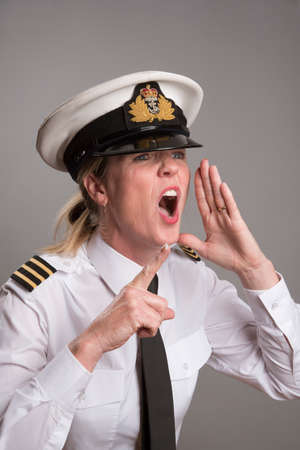 OFFICER SHOUTS AN ORDER MAY 2016 - Portrait of a female uniformed officer shouting and pointing her forefinger