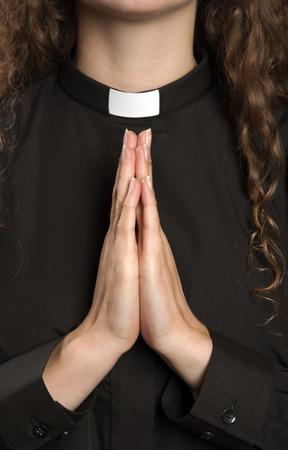 women praying: Hands clapsed together praying Stock Photo