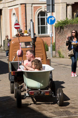 winchester: HAT FAIR WINCHESTER ENGLAND UK - JULY 2016 - Visitors to the annual Hat Fair taking a ride around the city in a mobile bathouse. Warm water and costumes are supplied. Editorial