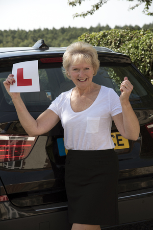 oap: Elderly woman driver with an self adhesive L plate Stock Photo