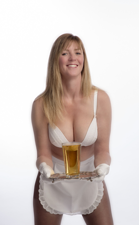 A scantily dressed waitress holding a silver tray and a glass of beer