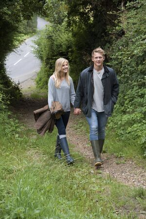 english countryside: A young couple walking in English countryside