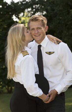 Portrait of two young airline officers kissing Stock Photo