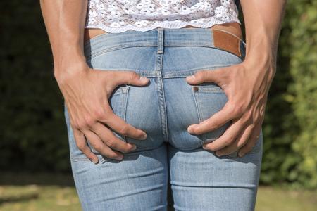 clutching: Mans hands clutching a girls backside
