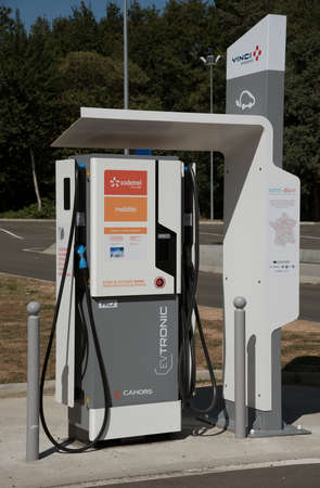 france station: Motorway car charging station France - August 2016 - A rapid charger for electric vehicles at a French autoroute service area