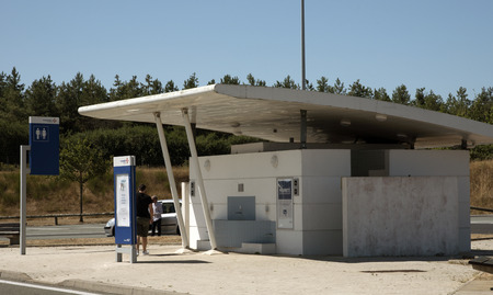 gent's: French autoroute service area - August 2016 - Male and female toilet facilities on a french motorway service area Editorial