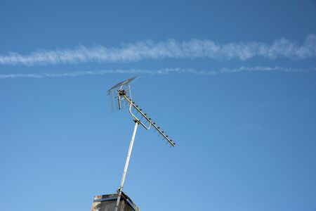 Vapour trails in the blue sky over central France