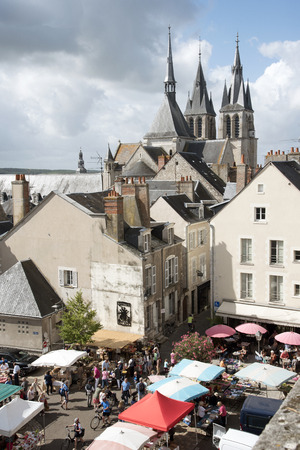 weekly market: Blois France - August 2016 - The Church of Saint Nicholas overlooks the weekly market in the town center of Blois situated in the Loire region of France Editorial