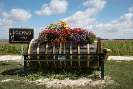 The Loire Valley France - August 2016 - An old wine press decorated in colorful flowers on the roadside at Vouvray in the Loire France