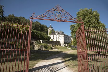 turreted: Chissey en Touraine Loire region France - August 2016 - The French turreted 15th century Chateau Chissey at Chissey en Touraine set on a wooded hillside