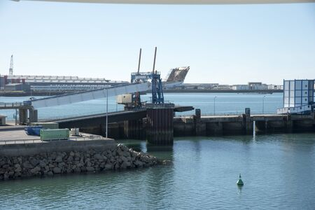 unload: Cherbourg France Linkspan used to load and unload vehicles from ferries stands empty in this quiet port