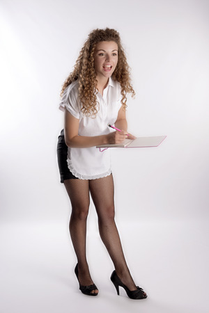 fishnet tights: Attractive young waitress taking an order Stock Photo