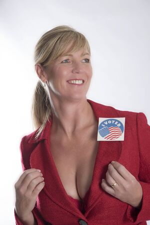 voted: Woman with a voting sticky label