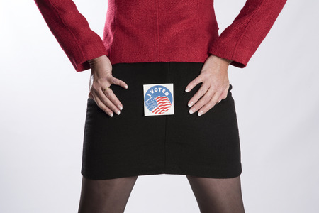 voted: Woman with a voting sticky label on her backside