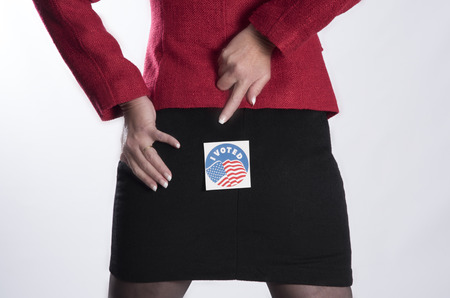 i voted: Woman with a voting sticky label on her backside