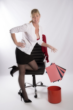 secretarial: Secretarial worker throwing away office files