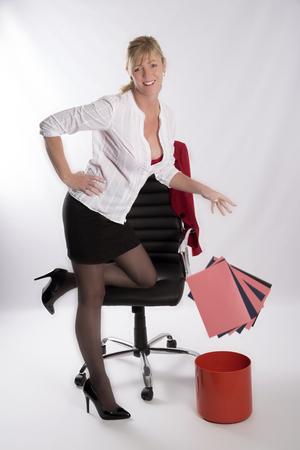 Secretarial worker throwing away office files