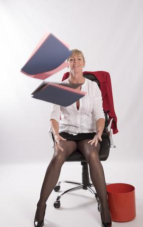 Secretary juggling office files