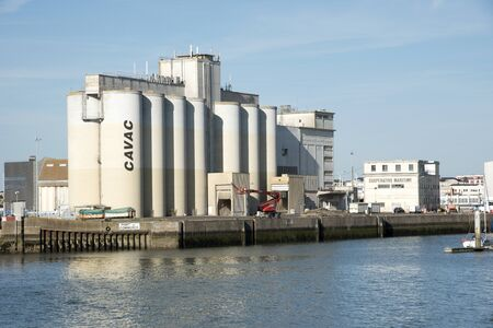 cooperativa: Les Sables DOlonne western France - August 2016 - The grain silos of CAVAC an agricultural cooperative in the port of this French coastal town Editorial