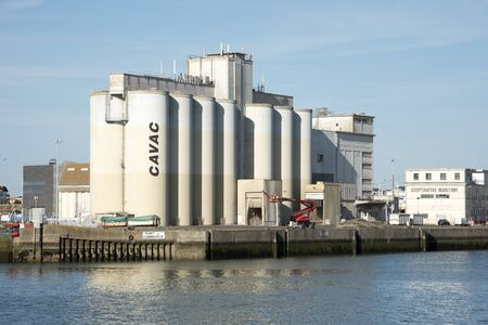 syndicate: Les Sables DOlonne western France - August 2016 - The grain silos of CAVAC an agricultural cooperative in the port of this French coastal town Editorial