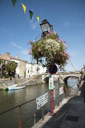 commune: Marans a commune in the Charente Maritime region of Southwest France - August 2016 - The Canal de Marans  La Rochelle at Morans with pleasure craft using the waterway