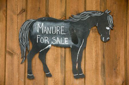 yard sign: Horse manure for sale sign - September 2016 - Manure for sale sign in a stable yard Stock Photo