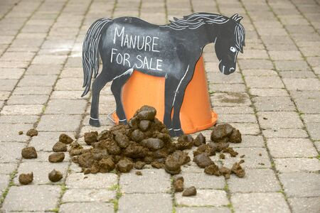 for sale sign: Horse manure for sale sign - September 2016 - Manure for sale sign in a stable yard Stock Photo