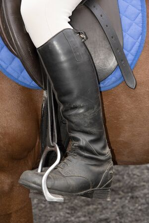 positioned: Riders safety stirrup September 2016 - A riding boot positioned into a bent leg safety stirrup used in horse riding