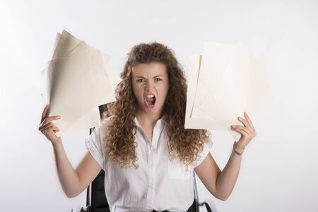 fedup: Secretary in an angry mood holding paper files Stock Photo