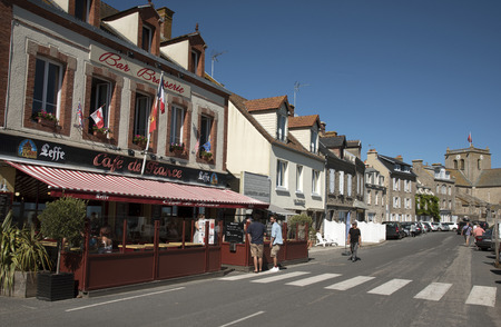 commune: The coastal commune of Barfleur in Normandy northwest France. Cafe on the quayside Editorial