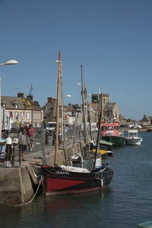 commune: The coastal commune of Barfleur in Normandy northwest France. Boats berthed in the small harbor