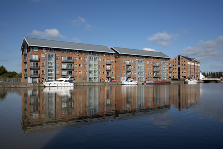 regenerated: Gloucester Docks Gloucestershire England UK - October 2016 - New build apartment blocks sitting waterside on the main basin of Gloucester Docks