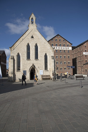 regenerated: Gloucester Docks Gloucestershire England UK - October 2016 - The Mariners Chapel and old warehouse buildings in the heart of Gloucester Docks Editorial