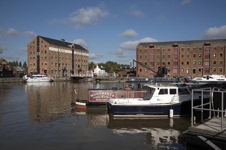 regenerated: Gloucester Docks Gloucestershire England UK - October 2016 - Refurbished warehouses on the boat lined main basin of Gloucester Docks
