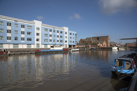 regenerated: Gloucetser Docks Gloucestershire England UK - October 2016 - On the waterside the blue and white painted building a part of the Gloucester College campus