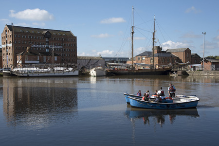 regenerated: Gloucester Docks Gloucestershire England UK - October 2016 - Sea cadets getting instruction on handling a boat on the main basin of the Gloucester Docks Editorial
