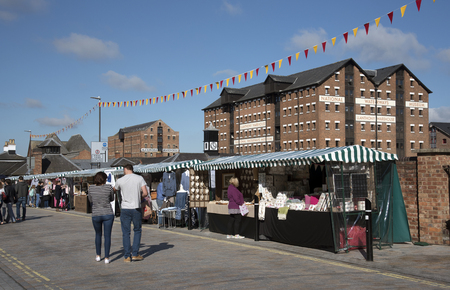 regenerated: Gloucester Docks Gloucestershire England UK - October 2016 - Market stalls and the National Waterways Museum within this most inland port in the UK Editorial