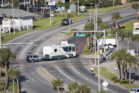 pensacola beach: Pensacola Beach Florida USA - October 2016 - Overview of a RV towing a car over a road junction controlled by a traffic light