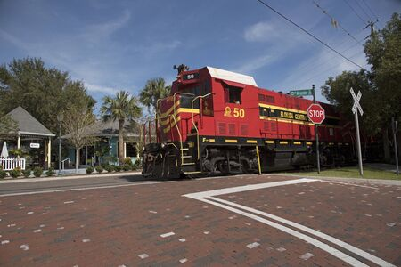 Mount Dora Florida USA - October 2016 - A freight pulling locomotive passing through the center of Mount Dora a small Florida town.