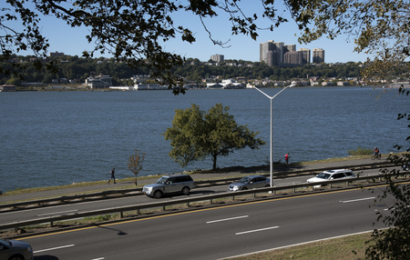 Hudson River New York USA - October 2016 - The Henry Hudson Parkway looking over the Hudson River to New jersey NYC